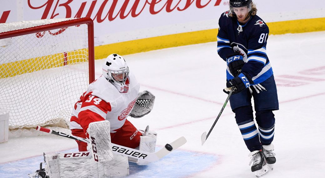 jets-kyle-connor-deflects-shot-towards-red-wings-eric-comrie