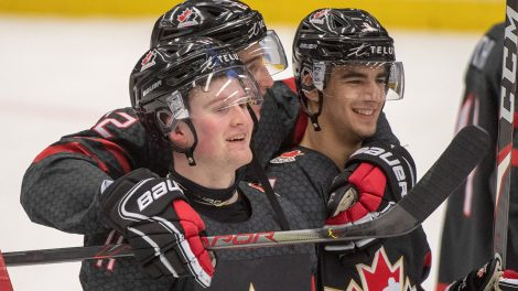 canadas-alexis-lafreniere-celebrates-with-teammates-after-win
