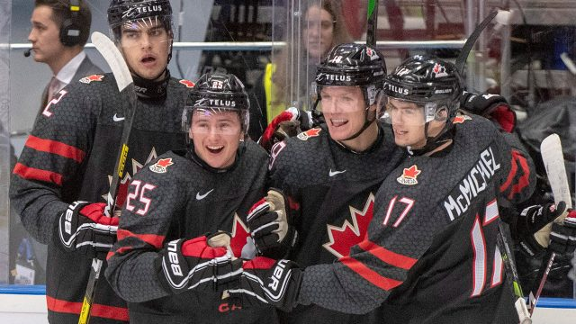 canadas-ty-dellandrea-celebrates-goal-against-finland-with-teammates