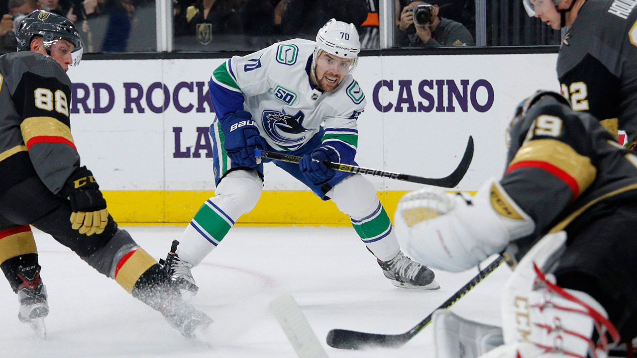 canucks-tanner-pearson-passes-puck-against-golden-knights