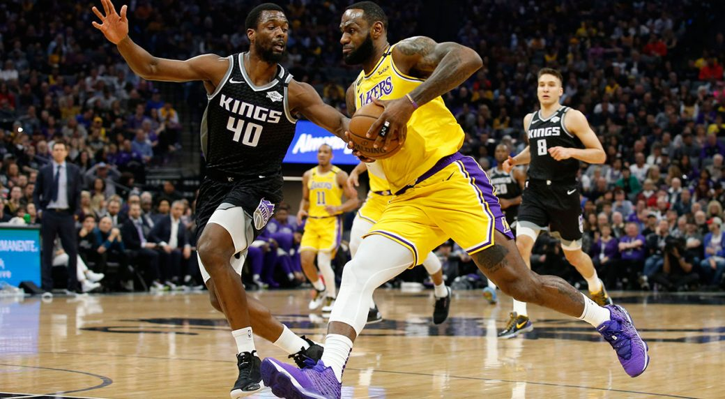 James has a triple-double, Lakers throttle Kings