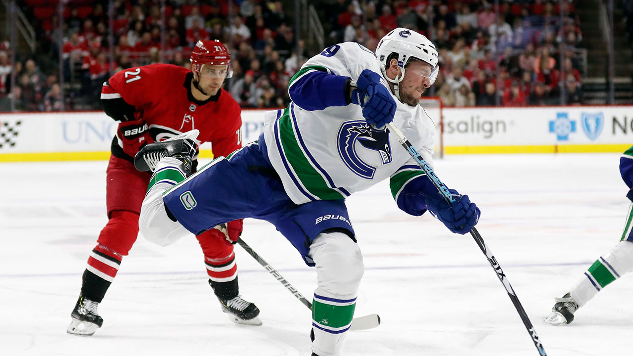 Canucks' battle back to earn a valuable point as their road work continues