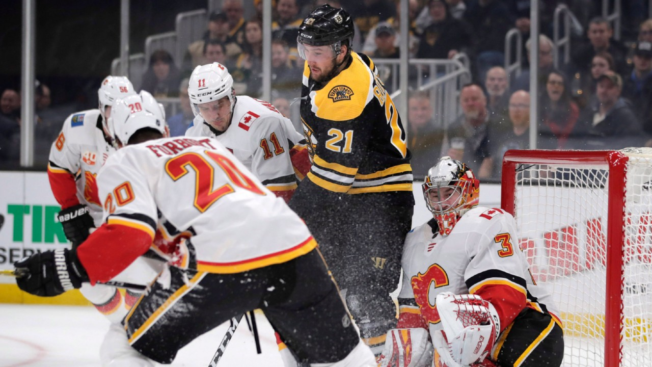 Flames turn up the heat and burn the Bruins in Beantown