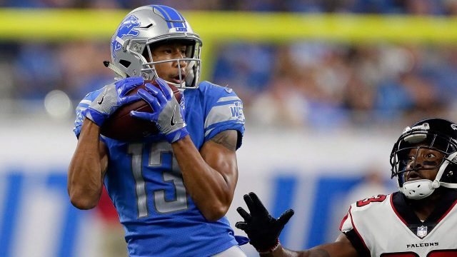 tj-jones-catches-pass-as-member-of-lions