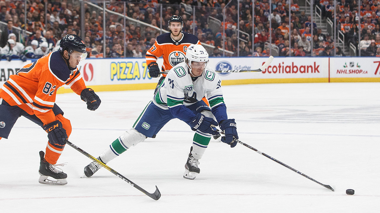 canucks-loui-eriksson-chased-by-oilers-caleb-jones