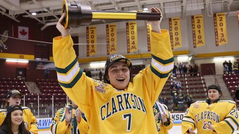clarksons-elizabeth-giguere-holds-up-trophy