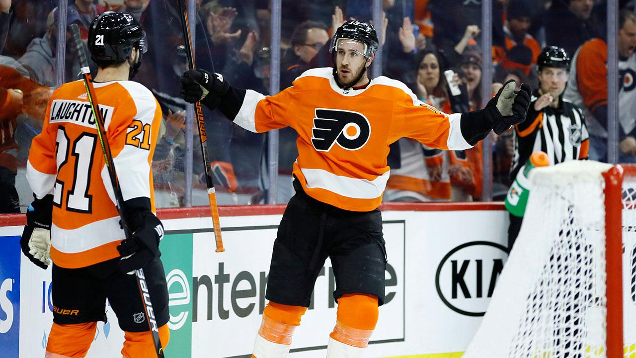 Philadelphia-Flyers'-Kevin-Hayes-(13)-celebrates-with-Scott-Laughton