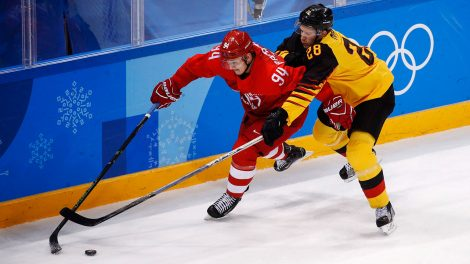 russias-alexander-barabanov-battles-to-keep-puck-at-olympics