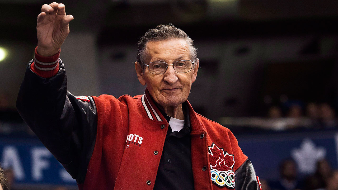 Walter-Gretzky,-father-of-hockey-hall-of-famer-Wayne-Gretzky,-waves-to-fans-as-the-Buffalo-Sabres-play-against-the-Toronto-Maple-Leafs-during-third-period-NHL-hockey-action-in-Toronto-in-2017