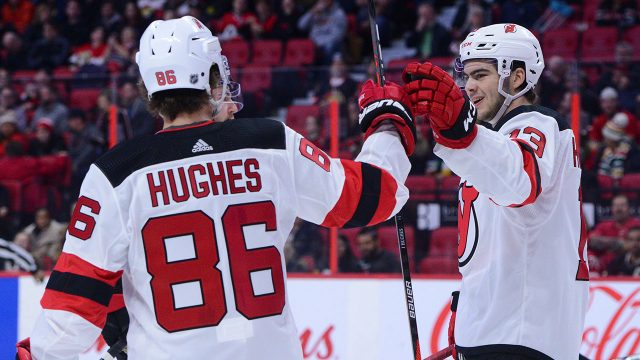 New-Jersey-Devils-centre-Nico-Hischier-celebrates-a-goal-with-Jack-Hughes