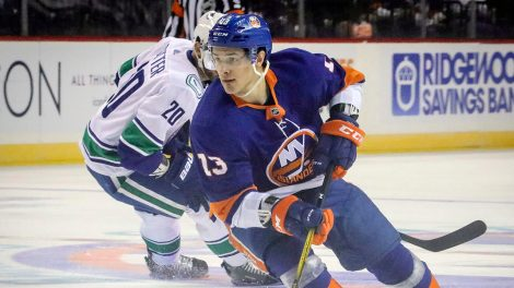New-York-Islanders-forward-Mathew-Barzal-controls-the-puck-during-an-NHL-hockey-game-against-Vancouver-Canucks