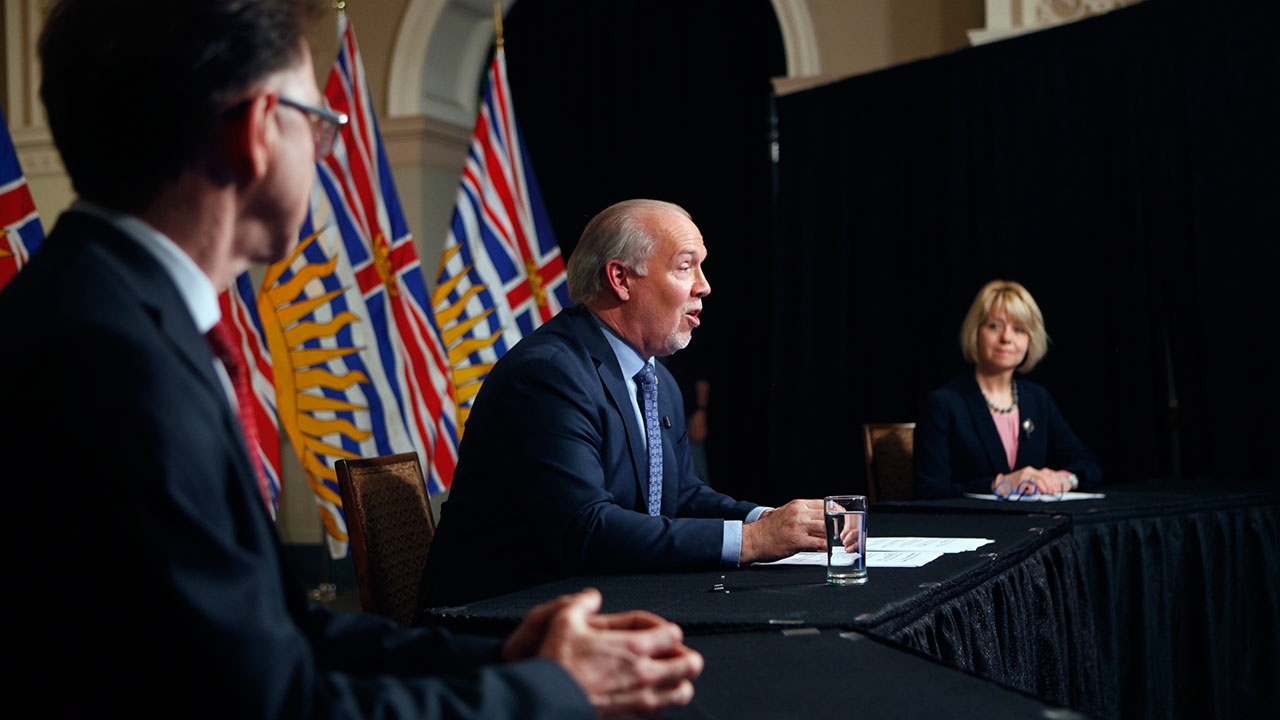 B.C.-Premier-John-Horgan-is-joined-by-Provincial-Health-Officer-Dr.-Bonnie-Henry-and-Health-Minister-Adrian-Dix-as-they-discuss-reopening-the-province's-economy-in-phases-in-response-to-the-COVID-19-pandemic