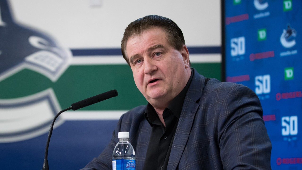 Canucks' Benning hopes players return to Vancouver this week as camp looms