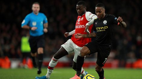 arsenals-nicolas-pepe-fights-for-ball-with-manchester-citys-raheem-sterling