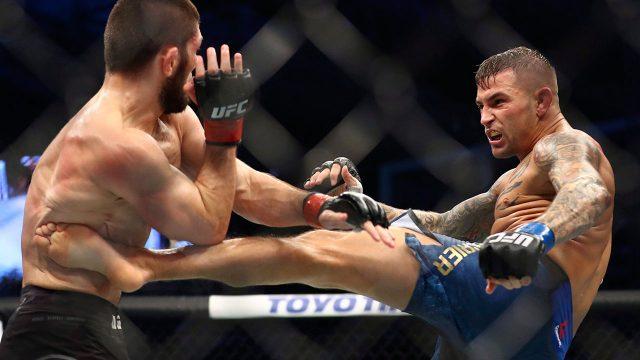 Dustin-Poirier,-right,-kicks-Khabib-Nurmagomedov-at-UFC-242