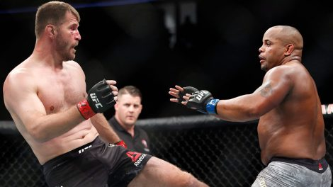 Stipe-Miocic-kicks-Daniel-Cormier-during-a-heavyweight-title-mixed-martial-arts-bout-at-UFC-226
