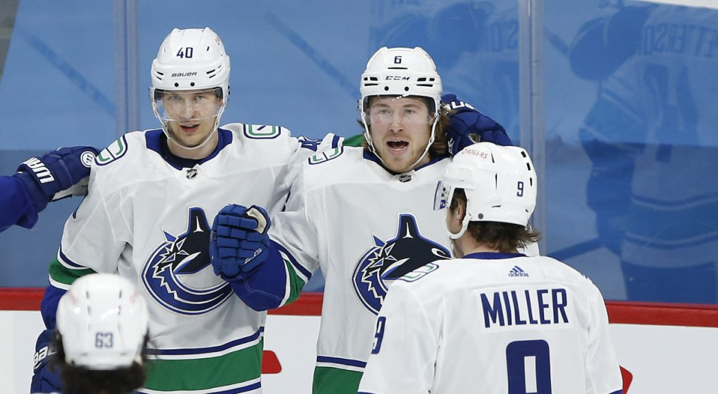 Canucks keep their streak alive with a rare win in the 'Peg