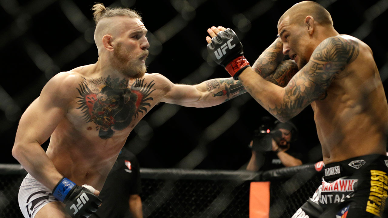 Conor-McGregor-punches-Dustin-Poirier-ufc-178
