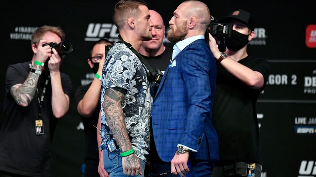 Dustin-Poirier-and-Conor-McGregor-face-off-for-media-during-the-UFC-257-press-conference-event-inside-Etihad-Arena-on-UFC-Fight-Island