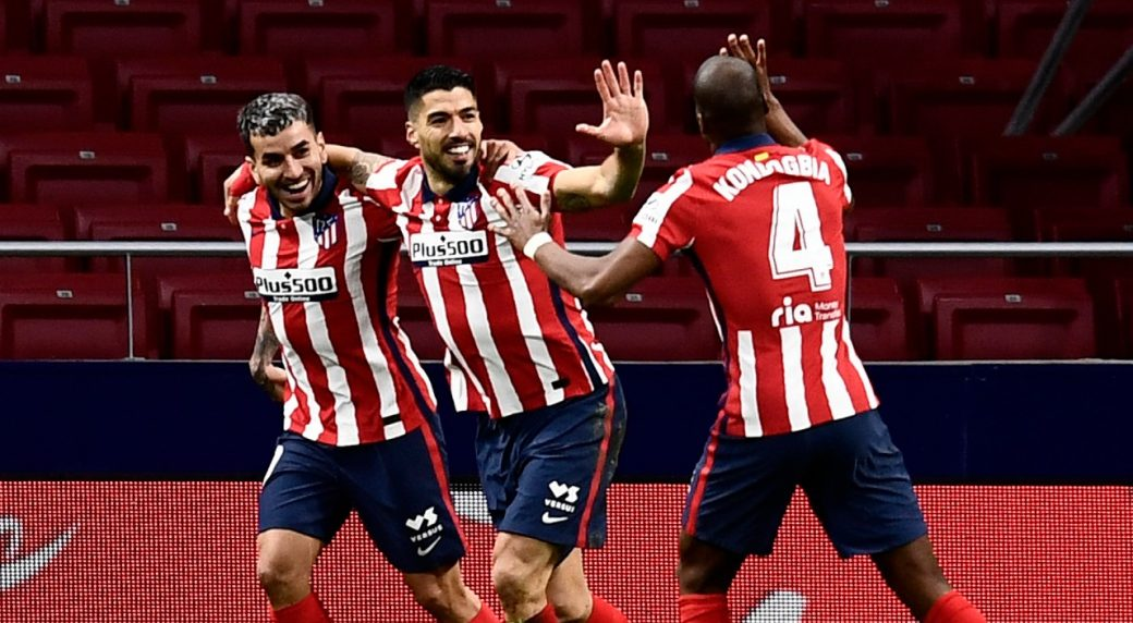 Atletico Madrid wins at Granada to resume title march