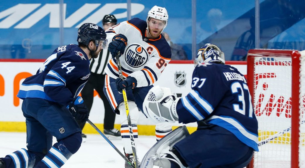 Jets' losing streak continues as McDavid and the Oilers take the win