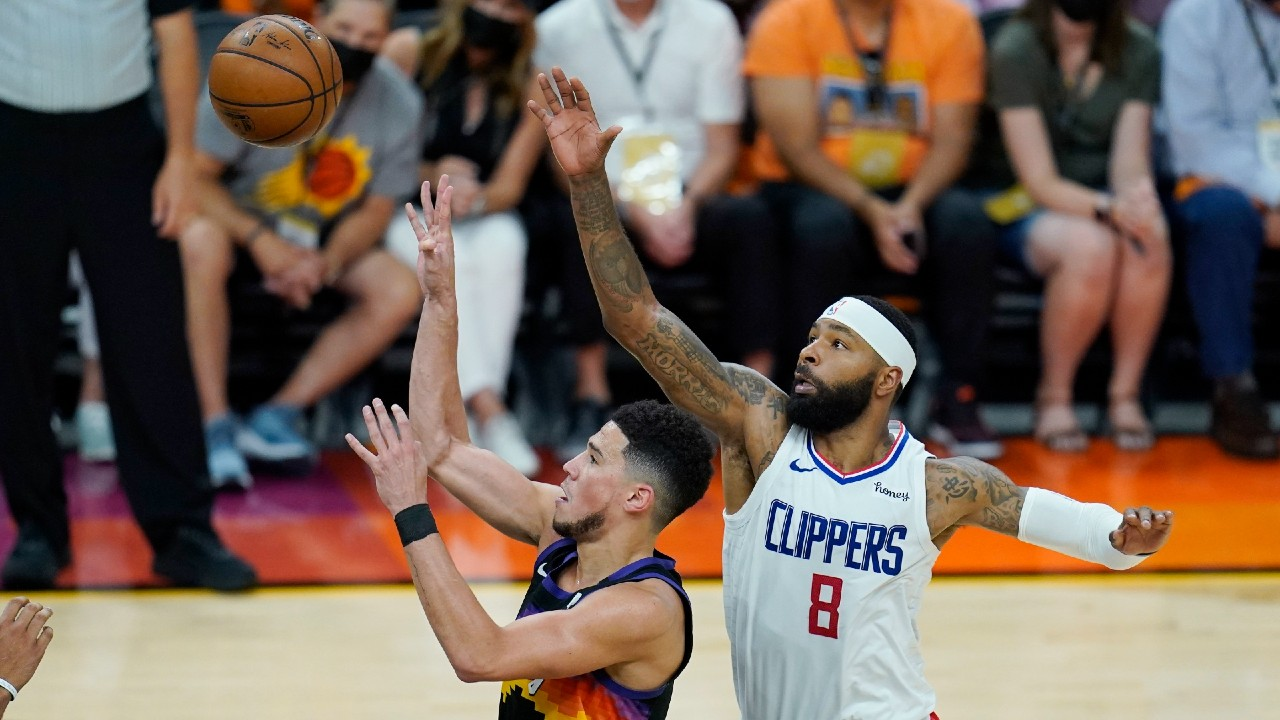 Booker gets his first career triple-double when Suns beat Clippers in Game 1